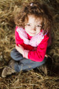 Child with fuzzy hair beautiful little sitting in hay Royalty Free Stock Images