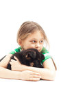 Child gently hugs puppy on white background Stock Images