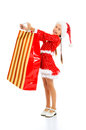 Child with gift bag dressed as santa Royalty Free Stock Photos