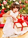 Child with gift box near Christmas tree. Stock Image