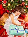 Child with gift box near christmas tree happy Royalty Free Stock Photo