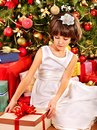 Child with gift box near christmas tree happy Royalty Free Stock Images
