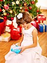Child with gift box near christmas tree happy Stock Photo