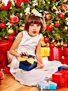 Child with gift box near christmas tree happy Royalty Free Stock Image