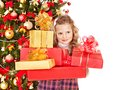 Child with gift box near christmas tree isolated Stock Photography