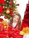 Child with gift box near christmas tree isolated Stock Images