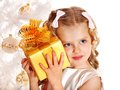 Child with gift box near white christmas tree isolated Stock Photos