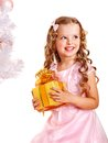 Child with gift box near white christmas tree isolated Stock Photography