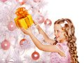 Child with gift box near white christmas tree isolated Royalty Free Stock Photo