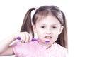 Child girl brushing teeth isolated on white background Royalty Free Stock Photo