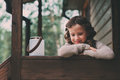 Child girl with candle holder relaxing in evening at cozy country house. Royalty Free Stock Photo