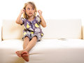 Child girl cell phone earphones Royalty Free Stock Photo