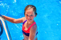 Child girl coming out of swimming pool . Royalty Free Stock Photo
