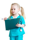 Child girl in costume of doctor takes notes