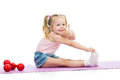 Child girl doing exercises and showing thumb up Royalty Free Stock Photography