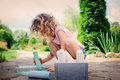 Child girl drawing with chalks in summer Royalty Free Stock Photo