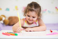 Child girl drawing by pen with felt tip Royalty Free Stock Images