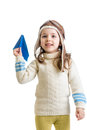 Child girl dressed as pilot playing with paper airplane isol Royalty Free Stock Photo