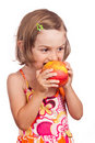 Child girl eating apple Royalty Free Stock Photo