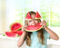 Child girl enjoy slice watermelon.Kid's healthy nutrition. Royalty Free Stock Photo