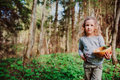 Child girl exploring nature in early spring forest. Kids learning to love nature. Teaching children about seasons changing. Royalty Free Stock Photo