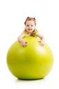 Child girl having fun with gymnastic ball kid fitness Stock Images
