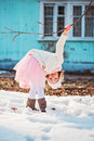 Child girl having fun on the walk in early spring pink skirt with melting snow ground Stock Images