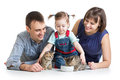 Child girl and her parents feeding small kittens kid Stock Photography