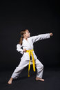 Child girl in karate suit with yellow belt show stance Royalty Free Stock Photo