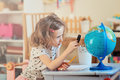 Child girl learning with globe at home Royalty Free Stock Photo