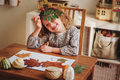 Child girl making herbarium at home autumn seasonal crafts cute Stock Image