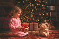 Child girl in nightgown with teddy bear in Christmas night Royalty Free Stock Photo