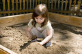 Child girl plaing at sand-box Stock Photo