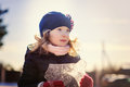 Child girl playing with block of ice on winter walk Royalty Free Stock Photo