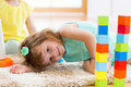 Child girl playing with block toys on floor Royalty Free Stock Photo