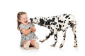 Child girl playing with dog puppy over white background Stock Image