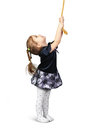 Child girl pulling a rope from top, isolated on white Royalty Free Stock Photo