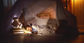 Child girl sleeping in tent with  book and flashlight Royalty Free Stock Photo