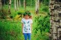 Child Girl In Summer Forest. I...