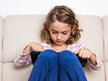 Child girl using digital tablet at home Royalty Free Stock Photo