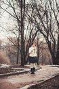 Child girl on the walk in early spring forest standing path way Royalty Free Stock Photography