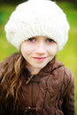Child girl in white cap close up portrait of adorable wearing Royalty Free Stock Image