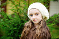 Child girl in white cap close up portrait of adorable wearing Stock Image