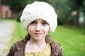 Child girl in white cap close up portrait of adorable wearing Royalty Free Stock Photo