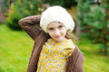 Child girl in white cap close up portrait of adorable wearing Royalty Free Stock Photography