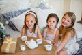 Child girls wake up in her bed in Christmas morning Royalty Free Stock Photo