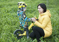 A child gives flowers to his mother, for a walk, a boy on a bicycle