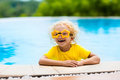 Child with goggles in swimming pool. Kids swim. Royalty Free Stock Photo