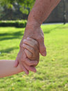Child and grandmother holding hands Stock Photography