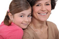 Child and grandmother stood close together Royalty Free Stock Photo